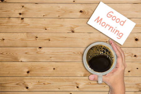 wakening: Good morning coffee cup top view on wooden table background