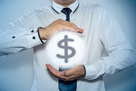 dollar symbol: businessman protecting dollar symbol Stock Photo