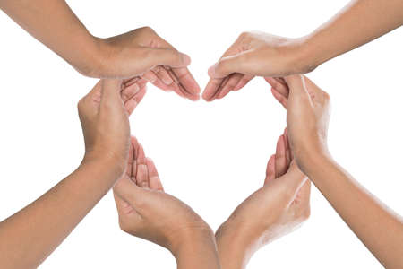 love shape: Heart formed by  female hands isolated on white Stock Photo