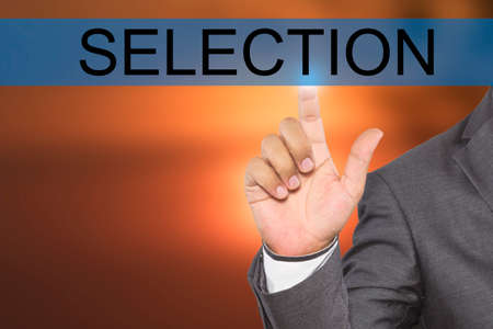tab: Businessman hand touching SELECTION tab on virtual screen