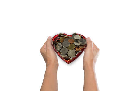 catchy: Love and money concept. Two Hand Holding Gold coin and Two Hand Holding heart shape