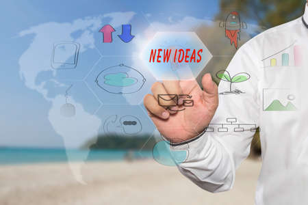 new ideas: pressing touch screen interface and select NEW IDEAS, business concept , business idea
