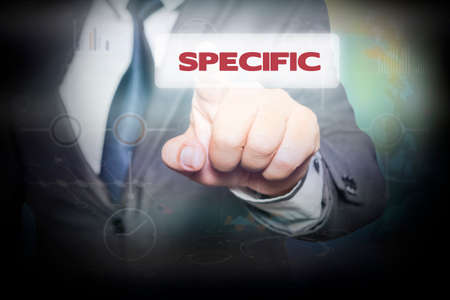 specific: Businessman pressing button on touch screen interface and select SPECIFIC. Business concept