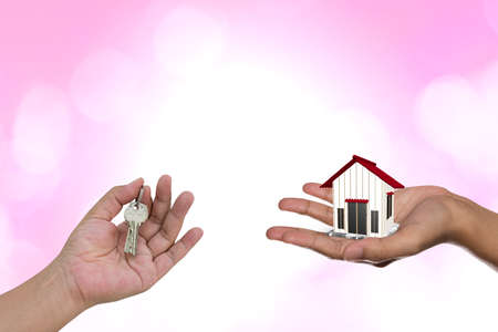 renter: Real estate agent with house model and keys on green backgrounds