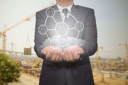 group network: Hand carrying businessman icon network - HR,HRM,MLM, teamwork & leadership concept