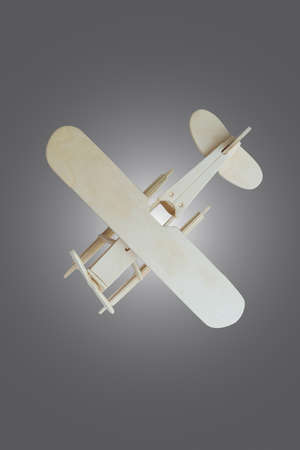 wooden toy: Toy wooden airplane on wooden table