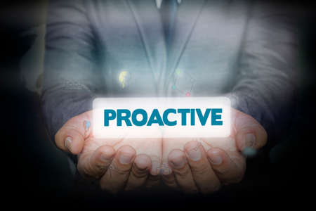 proactive: Businessman holding  icon with PROACTIVE words on the screen. business concept. Stock Photo