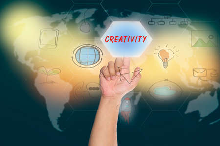 media distribution: pressing touch screen interface and select CREATIVITY, business concept , business idea