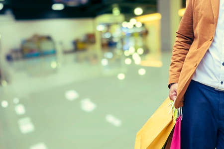 Happy shopping, male man hand holding shopping bags - Vintage Filter Stock Photo