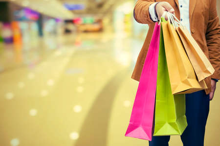 Happy shopping, male man hand holding shopping bags - Vintage Filter Editorial
