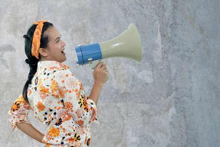 woman talking in megaphone, Shouting.