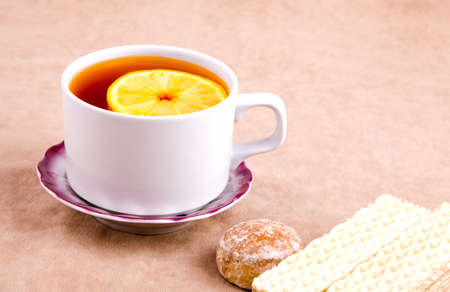 Tea with Lemon and sweet treats on the background of suede Stock Photo - 16501212