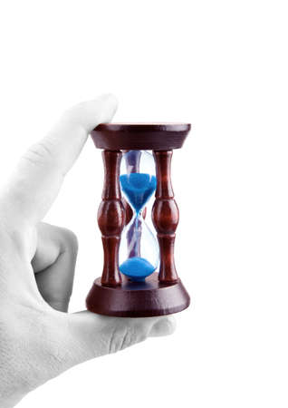 Hourglass in hand and time is non-stop  White background