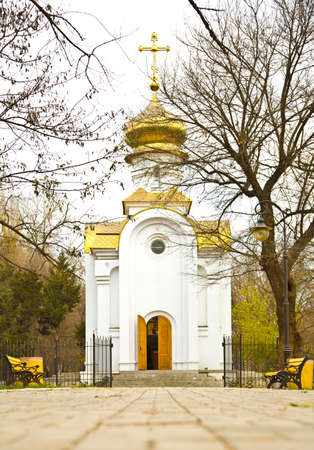 The small church in the autumn park