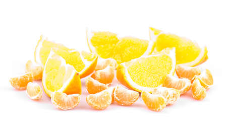Mandarin and orange on a white background, fruit slices, shallow depth of field
