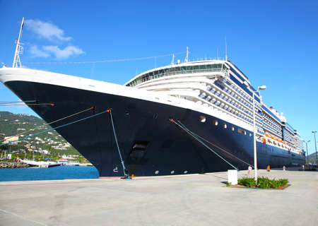 The cruise liner is moored at pier of the tropical island in a sunny day Stock Photo