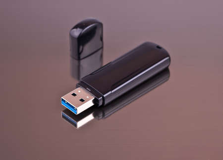 USB Flash drive on a gray background from aluminum for your site
