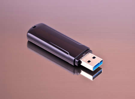 Flash drive on a gray background from aluminum for your site