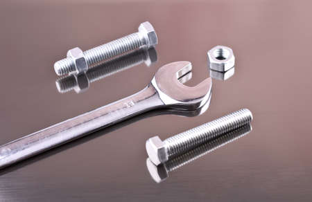 Wrench, nuts and bolts on a gray background from aluminum Stock Photo