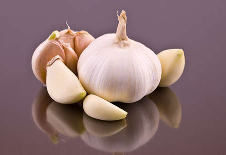 Garlic and garlic cloves on a gray background Stock Photo