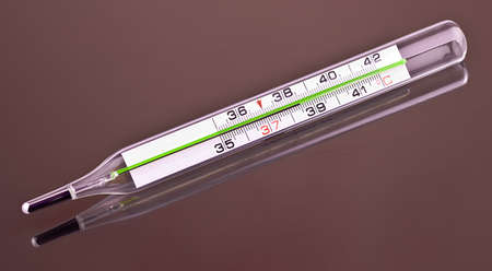 Thermometer with high temperature on gray background