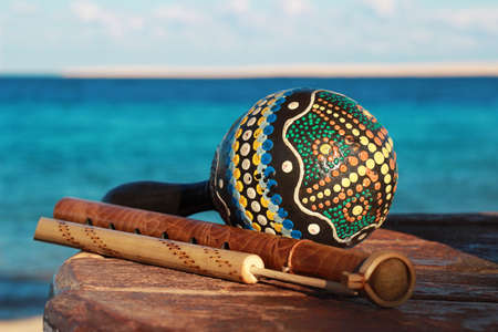 folk music: ethnic musical instruments with a sea background Stock Photo