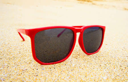 polarised: Sand background with sunglasses