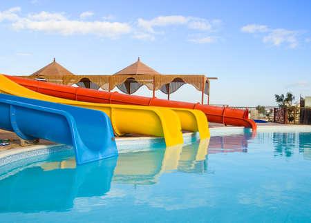 WATER SLIDE: water park slides  sunny summer day