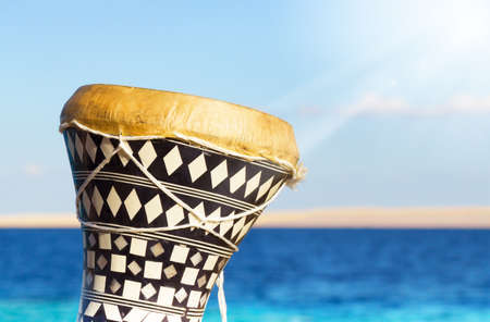 ethnic drum with a sea background  darbuka  traditional Egyptian drum
