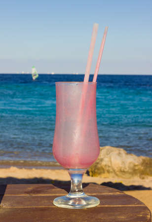 parting the sea: empty dirty glassful and cocktail straw Stock Photo