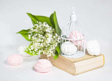 sweet marshmallows and lilies of the valley photo