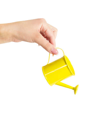 female hand holding a watering can