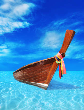 brown wooden boat in the blue sea photo