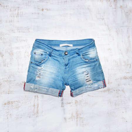 Jeans shorts in wood background Reklamní fotografie