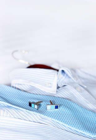 drycleaning: Mens classic shirts on the bed.