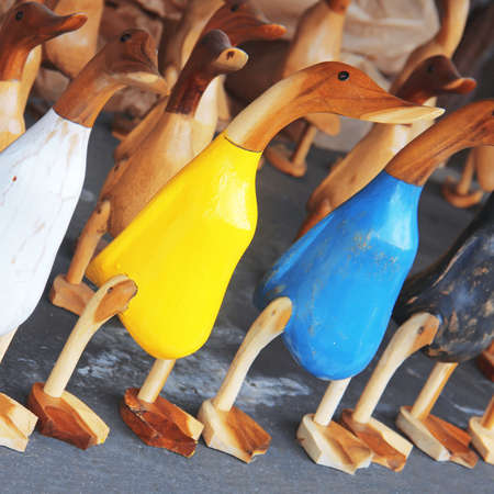 carvings: colorful wooden figurines of ducks, selective Focus