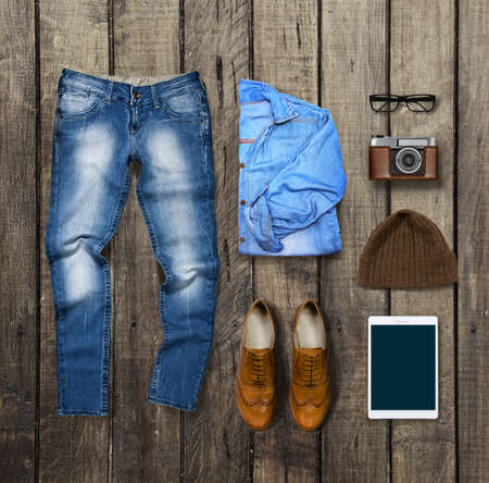 denim: clothes and accessories on brown Wood Background Stock Photo
