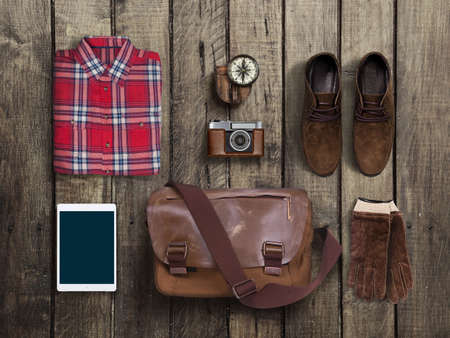 casual clothing: hipster clothes and accessories on a wooden background