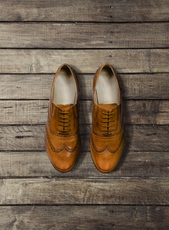 kinfolk: boots on brown Wood Background