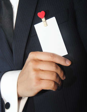 namecard: man holding a namecard with heart