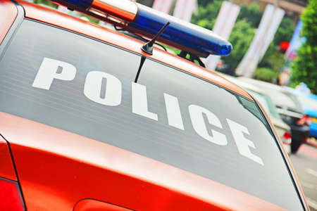 lightbar: Closeup of the orange police car with a sign POLICE. Stock Photo