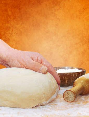 knead: womens hands knead the dough
