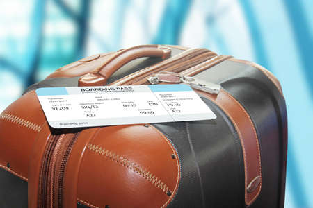 suitcase and boarding pass at the airport
