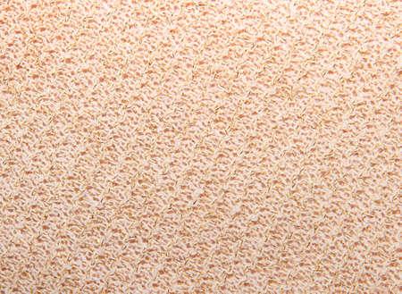 lurex: knitted beige background texture