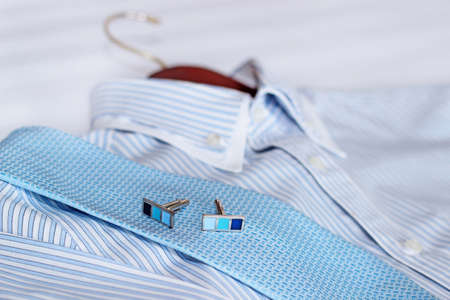 cleaning business: Mens classic shirts on the bed. Shallow depth of field