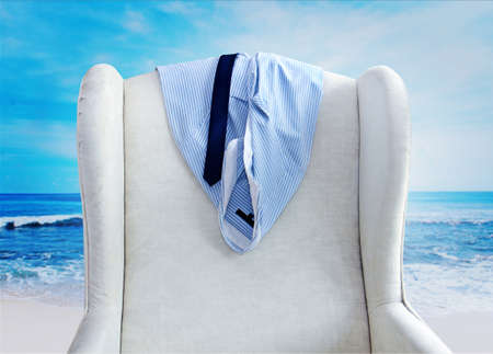 beach clothes: shirt and tie hanging on a chair