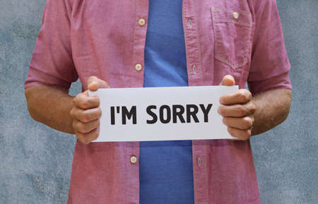 i am sorry: a man with a board in his hands