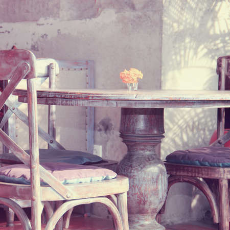 shabby: table on cafe background. vintage style