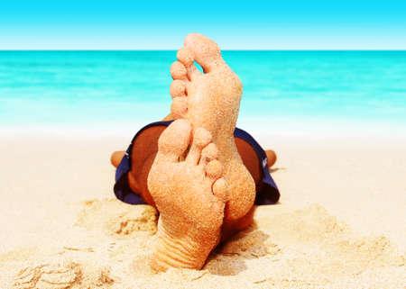 blue lagoon: man sleeping on the beach