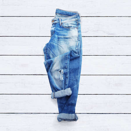 denim background: jeans on a white wooden background